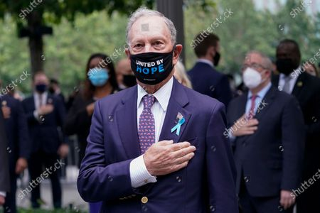 Former New York City Mayor Michael Bloomberg stands for the pledge of allegiance during a ceremony marking the 19th anniversary of the 9/11 terrorist attacks at the National September 11 Memorial & Museum, in New York