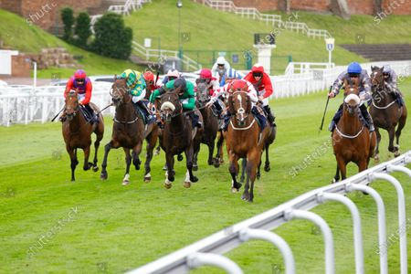 Sir Maximilian and David Probert [red colours] wins the Please Support The Injured Jockey's Fund Handicap at Chester from l-r Elegant Light, Shawaamekh, Baby Steps and Gabrial The Devil [right].