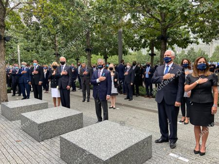 The traditional moment of silence is observed at 8:46 am on Friday, September 11, 2020 in New York, New York, marking the moment the first plane hit one of the two World Trade Center towers on September 11, 2001. Visible in the photo, from left to right: Jill Biden, former United States Vice President Joe Biden, the 2020 Democratic Party nominee for President of the United States, US Senate Minority Leader Chuck Schumer (Democrat of New York), former Mayor Michael Bloomberg (Independent of New York), US Senator Kirsten Gillibrand (Democrat of New York), US Vice President Mike Pence, and Karen Pence.