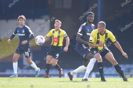 Richard Taylor of Southend and George Thomson of Harrogate Town in action during Sky Bet League Two match between Southend and Harrogate Town at Roots Hall in Southend, UK - 12th September 2020