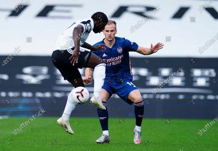 Stock Photo of Aboubakar Kamara of Fulham back heels past Rob Holding of Arsenal