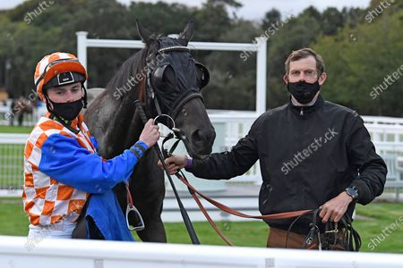 Stock Photo of Winner of The Racing TV Handicap Stakes Mere Anarchy (Orange/white cap 2r) ridden by Kieran Shoemark and trained by Robert Stephens in the Winners enclosure during Horse Racing at Salisbury Racecourse on 11th September 2020