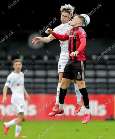 Stock Photo of Bohemians vs Waterford. Waterford's Matthew Smith and Andy Lyons of the Bohemians