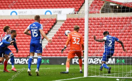 Mark Little of Bristol Rovers clears the ball off the goal line