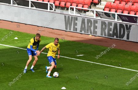 Tom Mehew of Bristol Rovers (left) and Michael Kelly of Bristol Rovers warm up before kick off