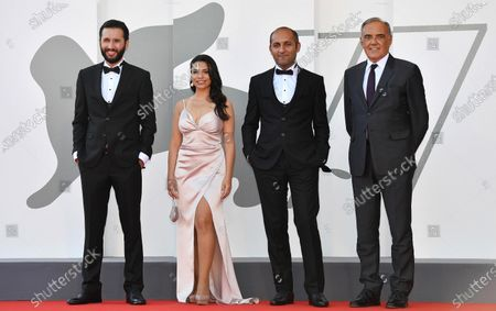 Azerbaijani actors Orkhan Iskandarli and Rana Asgarova, Azerbaijani filmmaker Hilal Baydarov and Festival Director Alberto Barbera arrive for the premiere of 'Sepelenmis Olumler Arasinda (In Between Dying)' during the 77th annual Venice International Film Festival, in Venice, Italy, 11 September 2020. The movie is presented in the Official Competition 'Venezia 77' at the festival running from 02 to 12 September. The event is the first major in-person film fest to be held in the wake of the Covid-19 coronavirus pandemic. Attendees have to follow strict safety measures like mandatory face masks indoors, temperature scanners, and socially distanced screenings to reduce the risk of infection. The public is barred from the red carpet, and big stars are expected to be largely absent this year. The 77th edition of the festival runs from 02 to 12 September 2020.