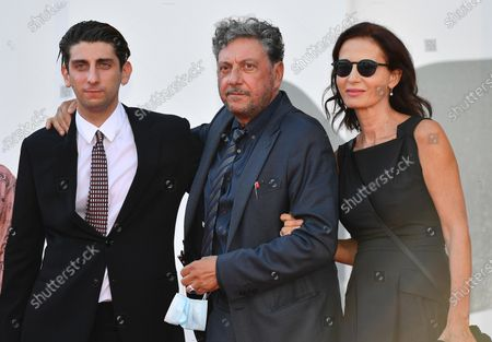 Pietro Castellitto (L) with his father Italian actor Sergio Castellitto (C) and his mother Italian writer Margaret Mazzantini (R) arrive for the premiere of 'I Predatori' during the 77th annual Venice International Film Festival, in Venice, Italy, 11 September 2020. The movie is presented in the Orizzonti section at the festival running from 02 September to 12 September. The event is the first major in-person film fest to be held in the wake of the Covid-19 coronavirus pandemic. Attendees have to follow strict safety measures like mandatory face masks indoors, temperature scanners, and socially distanced screenings to reduce the risk of infection. The public is barred from the red carpet, and big stars are expected to be largely absent this year.