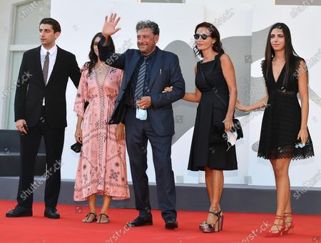 Pietro Castellitto arrives with his parents and sisters Maria Castellitto, Sergio Castellitto, Margaret Mazzantini and Anna Castellitto for the premiere of 'I Predatori' during the 77th annual Venice International Film Festival, in Venice, Italy, 11 September 2020. The movie is presented in the Orizzonti section at the festival running from 02 September to 12 September. The event is the first major in-person film fest to be held in the wake of the Covid-19 coronavirus pandemic. Attendees have to follow strict safety measures like mandatory face masks indoors, temperature scanners, and socially distanced screenings to reduce the risk of infection. The public is barred from the red carpet, and big stars are expected to be largely absent this year.