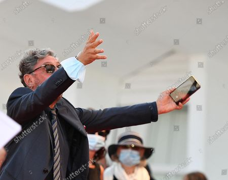 Stock Picture of Sergio Castellitto arrives for the premiere of 'I Predatori' during the 77th annual Venice International Film Festival, in Venice, Italy, 11 September 2020. The movie is presented in the Orizzonti section at the festival running from 02 September to 12 September. The event is the first major in-person film fest to be held in the wake of the Covid-19 coronavirus pandemic. Attendees have to follow strict safety measures like mandatory face masks indoors, temperature scanners, and socially distanced screenings to reduce the risk of infection. The public is barred from the red carpet, and big stars are expected to be largely absent this year.