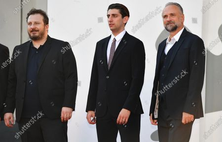 Pietro Castellitto (C) and Italian actors Massimo Popolizio (R) and Giorgio Montanini (L) arrive for the premiere of 'I Predatori' during the 77th annual Venice International Film Festival, in Venice, Italy, 11 September 2020. The movie is presented in the Orizzonti section at the festival running from 02 September to 12 September. The event is the first major in-person film fest to be held in the wake of the Covid-19 coronavirus pandemic. Attendees have to follow strict safety measures like mandatory face masks indoors, temperature scanners, and socially distanced screenings to reduce the risk of infection. The public is barred from the red carpet, and big stars are expected to be largely absent this year.