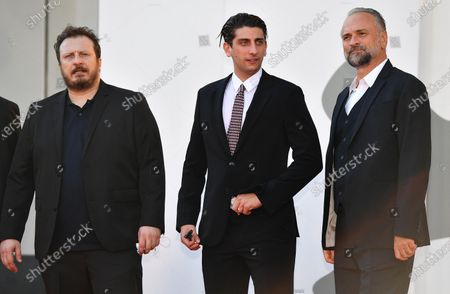 Pietro Castellitto (C) and Italian actors Massimo Popolizio (R) and Giorgio Montanini (L) arrive for the premiere of 'I Predatori' during the 77th annual Venice International Film Festival, in Venice, Italy, 11 September 2020. The movie is presented in the Orizzonti section at the festival running from 02 September to 12 September. The event is the first major in-person film fest to be held in the wake of the Covid-19 coronavirus pandemic. Attendees have to follow strict safety measures like mandatory face masks indoors, temperature scanners, and socially distanced screenings to reduce the risk of infection. The public is barred from the red carpet, and big stars are expected to be largely absent this year. The 77th edition of the festival runs from 02 to 12 September 2020.