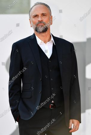 Massimo Popolizio arrives for the premiere of 'I Predatori' during the 77th annual Venice International Film Festival, in Venice, Italy, 11 September 2020. The movie is presented in the Orizzonti section at the festival running from 02 September to 12 September. The event is the first major in-person film fest to be held in the wake of the Covid-19 coronavirus pandemic. Attendees have to follow strict safety measures like mandatory face masks indoors, temperature scanners, and socially distanced screenings to reduce the risk of infection. The public is barred from the red carpet, and big stars are expected to be largely absent this year. The 77th edition of the festival runs from 02 to 12 September 2020.