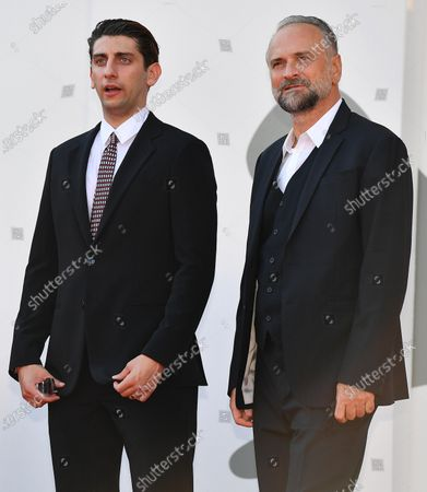 Pietro Castellitto (L) and Italian actor Massimo Popolizio (R) arrive for the premiere of 'I Predatori' during the 77th annual Venice International Film Festival, in Venice, Italy, 11 September 2020. The movie is presented in the Orizzonti section at the festival running from 02 September to 12 September. The event is the first major in-person film fest to be held in the wake of the Covid-19 coronavirus pandemic. Attendees have to follow strict safety measures like mandatory face masks indoors, temperature scanners, and socially distanced screenings to reduce the risk of infection. The public is barred from the red carpet, and big stars are expected to be largely absent this year. The 77th edition of the festival runs from 02 to 12 September 2020.