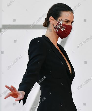 Italian Polish-born actress Kasia Smutniak  weas a protective face mask as she arrives for the premiere of 'I Predatori' during the 77th annual Venice International Film Festival, in Venice, Italy, 11 September 2020. The movie is presented in the Orizzonti section at the festival running from 02 September to 12 September. The event is the first major in-person film fest to be held in the wake of the Covid-19 coronavirus pandemic. Attendees have to follow strict safety measures like mandatory face masks indoors, temperature scanners, and socially distanced screenings to reduce the risk of infection. The public is barred from the red carpet, and big stars are expected to be largely absent this year.