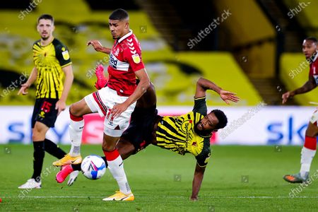 Middlesbrough forward Ashley Fletcher (11) defends the ball from Watford midfielder Nathaniel Chalobah (14) during the EFL Sky Bet Championship match between Watford and Middlesbrough at Vicarage Road, Watford