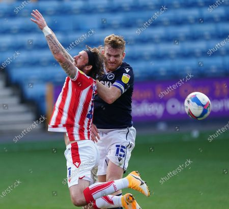 Steven Fletcher of Stoke City reacts to a challenge from Alex Pearce of Millwall