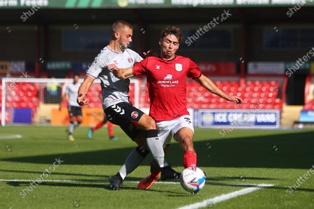 Charlie Barker of Charlton tackles Crewe's Harry Pickering