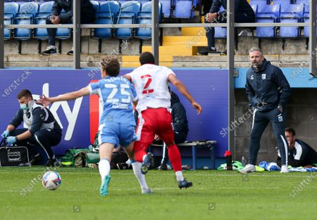 Barrow manager David Dunn bards out instructions