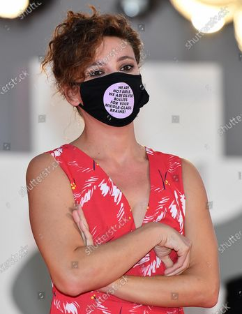 Jasmine Trinca wears a face mask as she arrives for the premiere of 'Nomadland' during the 77th annual Venice International Film Festival, in Venice, Italy, 11 September 2020. The movie is presented in the official competition 'Venezia 77' at the festival running from 02 September to 12 September.  The event is the first major in-person film fest to be held in the wake of the Covid-19 coronavirus pandemic. Attendees have to follow strict safety measures like mandatory face masks indoors, temperature scanners, and socially distanced screenings to reduce the risk of infection. The public is barred from the red carpet, and big stars are expected to be largely absent this year. The 77th edition of the festival runs from 02 to 12 September 2020.