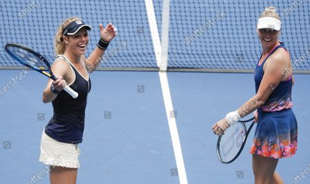 Teammates Laura Siegemund (L) of Germany and Vera Zvonareva (R) of Russia celebrate defeating Nicole Melichar of the US and Yifan Xu of China in the women's doubles final match on the twelfth day of the US Open Tennis Championships the USTA National Tennis Center in Flushing Meadows, New York, USA, 11 September 2020. Due to the coronavirus pandemic, the US Open is being played without fans and runs from 31 August through 13 September.