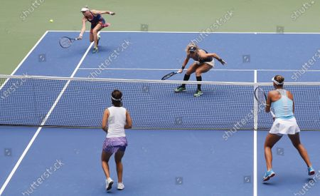 Teammates Vera Zvonareva of Russia (L) and Laura Siegemund of Germany (2-R) play a return to Nicole Melichar (R) of the US and Yifan Xu (2-L) of China during the women's doubles final match, which Zvonareva and Siegemund won, on the twelfth day of the US Open Tennis Championships the USTA National Tennis Center in Flushing Meadows, New York, USA, 11 September 2020. Due to the coronavirus pandemic, the US Open is being played without fans and runs from 31 August through 13 September.
