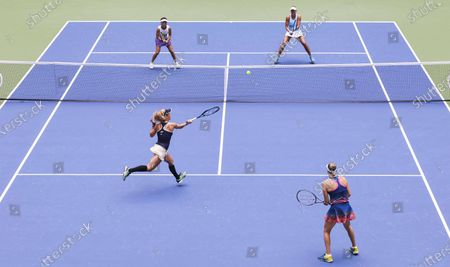 Stock Picture of Teammates Laura Siegemund (L) of Germany Vera Zvonareva of Russia (R) play a return to Nicole Melichar (R, top) of the US and Yifan Xu (L, top) of China during the women's doubles final match, which Zvonareva and Siegemund won, on the twelfth day of the US Open Tennis Championships the USTA National Tennis Center in Flushing Meadows, New York, USA, 11 September 2020. Due to the coronavirus pandemic, the US Open is being played without fans and runs from 31 August through 13 September.