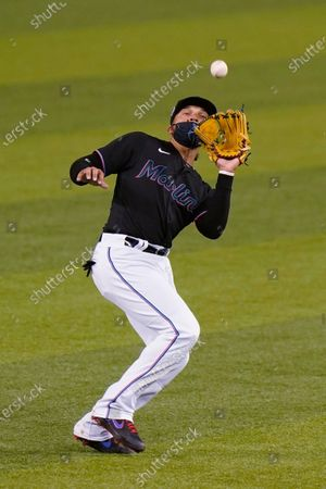 Miami Marlins second baseman Isan Díaz catches a ball hit by Philadelphia Phillies' Andrew McCutchen during the first inning of the second game of a baseball doubleheader, in Miami