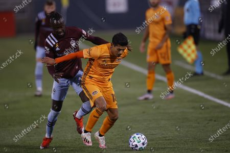 Stock Photo of Colorado Rapids forward Kei Kamara (23) and Houston Dynamo defender Jose Bizama (18) during the first half of an MLS soccer match, in Commerce City, Colo