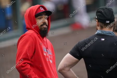 Stock Picture of Los Angeles Angels third baseman Anthony Rendon, left, talks with Colorado Rockies first baseman Daniel Murphy as the former Washington Nationals teammates talk before a baseball game, in Denver