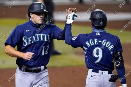 Stock Picture of Seattle Mariners' Evan White (12) high fives Dee Strange-Gordon