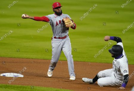 Los Angeles Angels second baseman Luis Rengifo, left, throws to first base after putting out Colorado Rockies' Kevin Pillar, right, at second base on the front end of a double play hit into by Matt Kemp in the fourth inning of a baseball game, in Denver