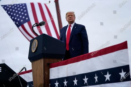 President Donald Trump arrives for a campaign rally at MBS International Airport in Freeland, Mich. Pushing for new roads to reelection, Trump will go on offense this weekend in Nevada, a state that hasn't supported a Republican presidential candidate since 2004