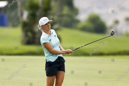 Mel Reid of England, watches her shot on the 18th hole during the second round of the LPGA's ANA Inspiration golf tournament at Mission Hills Country Club in Rancho Mirage, Calif