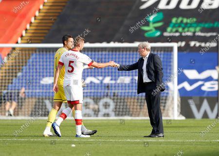 Crystal Palace Manager Roy Hodgson fist bumps Jack Stephens and Goalkeeper Alex McCarthy of Southampton; Selhurst Park, London, England; English Premier League Football, Crystal Palace versus Southampton.