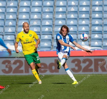 Richard Stearman of Huddersfield Town plays the ball forward; 12th September 2020 The John Smiths Stadium, Huddersfield, Yorkshire, England; English Championship Football, Huddersfield Town versus Norwich City.