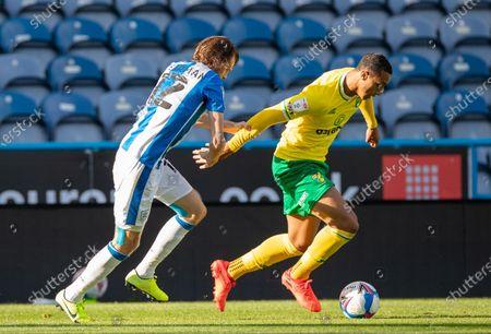 Adam Idah of Norwich City tracked by Richard Stearman of Huddersfield Town; 12th September 2020 The John Smiths Stadium, Huddersfield, Yorkshire, England; English Championship Football, Huddersfield Town versus Norwich City.