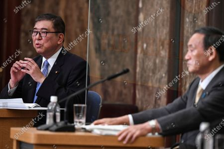 Japan's Liberal Democratic Party's leadership election candidates, former Japan's Defence Minister Shigeru Ishiba, left, and Japan's Chief Cabinet Secretary Yoshihide Suga attend a debate ahead of the LDP's leadership election, in Tokyo . The party plans a vote on Sept. 14 to choose Shinzo Abe's replacement as party chief