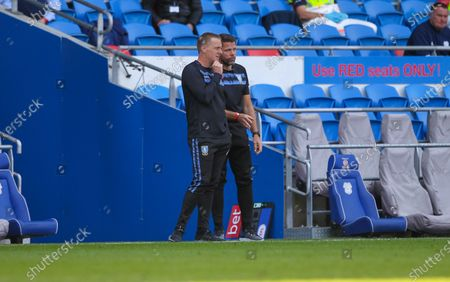 Stock Photo of Garry Monk manager of Sheffield Wednesday speaks with assistant James Beattie; Cardiff City Stadium, Cardiff, Glamorgan, Wales; English Championship Football, Cardiff City versus Sheffield Wednesday.