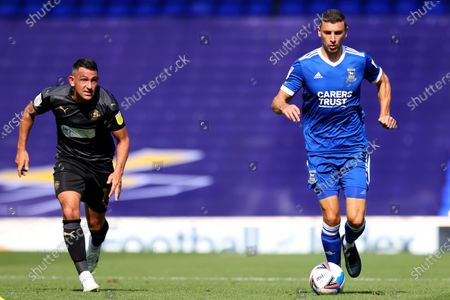 James Wilson of Ipswich Town sprints away from Gary Roberts of Wigan Athletic; Portman Road, Ipswich, Suffolk, England, English League One Footballl, Ipswich Town versus Wigan Athletic.