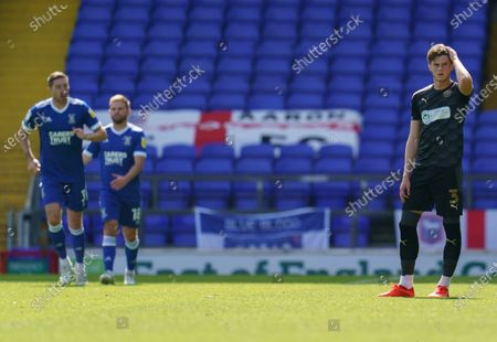 Tom Pearce of Wigan Athletic looks dejected after the goal by Teddy Bishop of Ipswich Town, 1-0