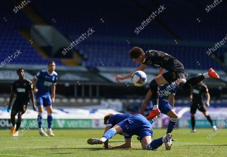 Jon Nolan of Ipswich Town tackles Tom Pearce of Wigan Athletic