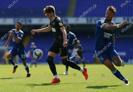 Tom Pearce of Wigan Athletic and Luke Chambers of Ipswich Town