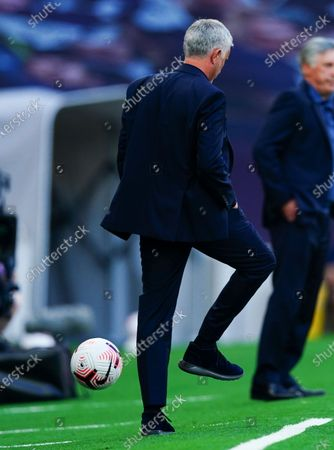 Stock Image of Tottenham manager Jose Mourinho back heels the ball