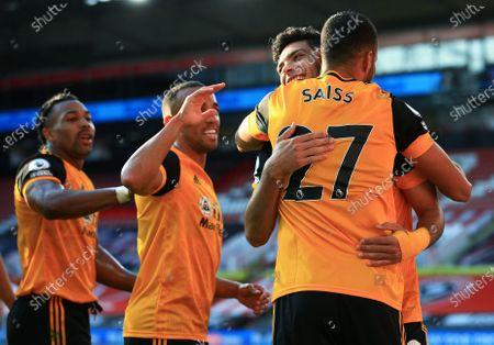 Romain Saiss of Wolverhampton Wanderers celebrates scoring a goal to make it 0-2 with Raul Jimenez