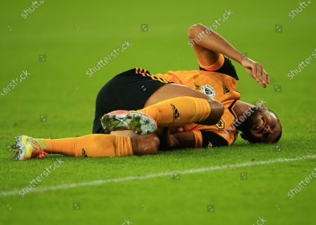 Romain Saiss of Wolverhampton Wanderers feels the pain from a knock