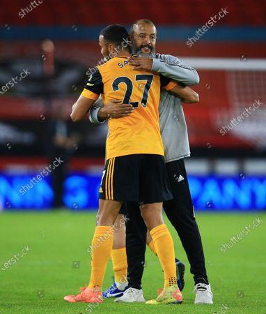 Wolverhampton Wanderers manager Nuno Espirito Santo hugs Romain Saiss