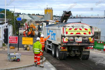 Road works being carried out on the approach road to Cable Wharf, a new Brownfield land housing development built on land of  a demolished industrial site in Gravesend.