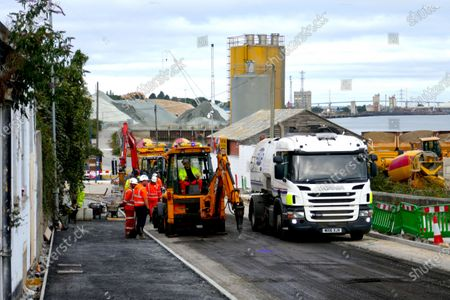 Stock Picture of Road works being carried out on the approach road to Cable Wharf, a new Brownfield land housing development built on land of  a demolished industrial site in Gravesend.