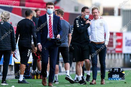 Bristol City Head of Performance Andy Rolls congratulates Bristol City head coach Dean Holden after a 2-1 win