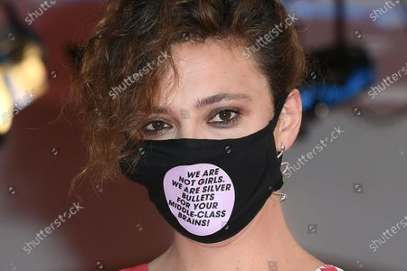 Jasmine Trinca wears a face mask with the inscription: 'We are not girls, we are silver bullets for your middle-class brains!'